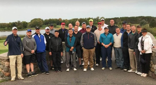 group photo of male golfers